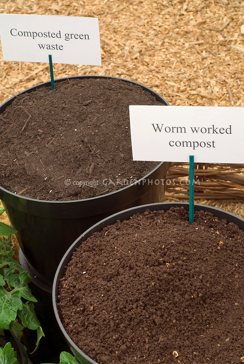 Compost types compared side by side: green waste and worm worked, in containers with sign labels, for garden use