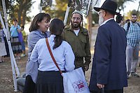 Ultra-Orthodox family meet their son who is a fighter from the Netzah Yehuda Battalion in the Israeli army, aftertheir swearing-in ceremony on Ammunition Hill in Jerusalem.