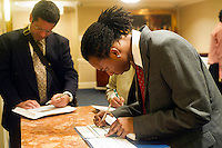 Job seekers attend a job fair in midtown in New York on Thursday, September 15, 2011.  ( © Frances M. Roberts)