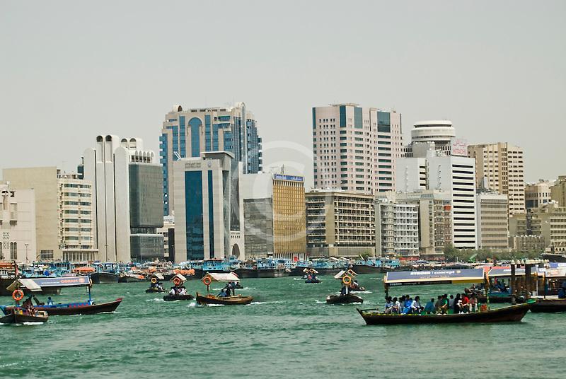 United Arab Emirates, Dubai, Deira skyline and abra ferries on Dubai Creek