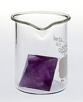 CRYSTAL DOES NOT TAKE CONTAINER SHAPE<br /> A solid (fluorite crystal) has its own shape. It will not fill a container conforming to the shape of the container unless it is finely divided.