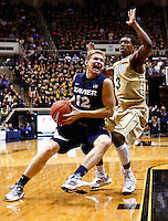 WEST LAFAYETTE, IN - DECEMBER 01: Brad Redford #12 of the Xavier Musketeers dribbles to the hoop as Ronnie Johnson #3 of the Purdue Boilermakers defends at Mackey Arena on December 1, 2012 in West Lafayette, Indiana. Xavier defeated Purdue 63-57. (Photo by Michael Hickey/Getty Images) *** Local Caption *** Brad Redford; Ronnie Johnson