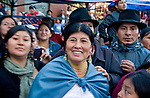 People watch President Correa in crowded market place in Otavalo Ecuador