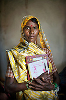 Ruhelin Bai Bagdaria, age 47, is one of the only women in her village who can read and write. Though she still works in the fields like everyone else, the fact she is literate means she is less likely to suffer the exploitation of others...Gadchiroli District.Maharashtra. India.September 2008.