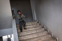 In this Thursday, Sep. 26, 2013 photo, a Syrian child runs downstairs at the public school in Madaya village as classes started in the Idlib province countryside of Syria. Children have come back to school in the rebel controlled territory despite the constant threaten of shelling and the ongoing fighting, and public schools still operating financially under the Syrian government administration. (AP Photo)