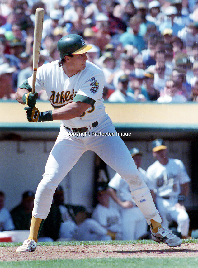 Oakland A's slugger Jose Canseco (1990 photo by Ron Riesterer)
