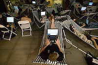 Attendees of the 6th edition of HOPE, an annual hackers' convention, spend time on their laptops as they lie in hammock chairs, July 22nd 2006, New York City, USA.