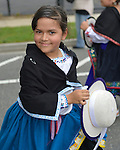 A young girl dancing in a blue dress and black shawl is with The Ecuadorian Community marchers in the Wantagh Independence Day Parade, a long-time July 4th tradition on Long Island.