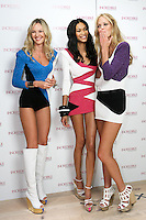 Chanel Iman, Candice Swanepoel, and Erin Heatherton pose together during the &quot;Incredible by Victoria's Secret&quot; launch at the Victoria Secret SOHO Store, August 10, 2010.