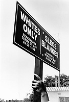 Demonstration under a 'whites only' sign in Carltonville, Johannesburg during the apartheid era.