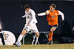 12 November 2013: Wake Forest's Ian Harkes (16) and Virginia's Eric Bird (11). The Wake Forest University Demon Deacons hosted the University of Virginia Cavaliers at Spry Stadium in Winston-Salem, North Carolina in a 2013 NCAA Division I Men's Soccer match and the quarterfinals of the Atlantic Coast Conference tournament. Virginia won the game 1-0 in overtime.