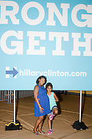 Alana Proctor-Duncan, 35, of Coral Springs, Florida, and daughter Madison Francis, 9, pose for pictures after a campaign rally for Democratic presidential nominee Hillary Clinton in the Theodore R. Gibson Health Center at Miami Dade College-Kendall Campus in Miami, Florida, USA. Former Vice President Al Gore also spoke at the rally.