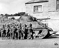Yanks of 60th Inf. Regt. advance into a Belgian town under the protection of a heavy tank.  September 9, 1944.  Spangle.  (Army)  NARA FILE #:  111-SC-193903<br /> WAR &amp; CONFLICT BOOK #:  1062