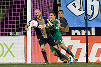 Conor Casey (6) of the Philadelphia Union and Toronto FC goalkeeper Joe Bendik (12) battle for the ball. The Philadelphia Union defeated Toronto FC 1-0 during a Major League Soccer (MLS) match at PPL Park in Chester, PA, on October 5, 2013.