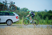 Bauke Mollema (NLD/Belkin) trailing the team car, trying to catch up to the peloton after a crash where he had to change his bike (no race number)<br /> <br /> 2014 Tour de France<br /> stage 4: Le Touquet-Paris-Plage/Lille M&eacute;tropole (163km)