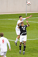 Alex Hadley (23) of the Cincinnati Bearcats goes over Greg Davis (14) of the Providence Friars for a header. The Providence Friars defeated the Cincinnati Bearcats 2-1 during the semi-finals of the Big East Men's Soccer Championship at Red Bull Arena in Harrison, NJ, on November 12, 2010.