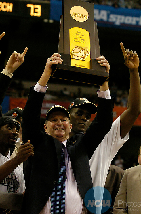 5 APR 2004: UConn head coach Jim Calhoun hoists the championship trophy following the Division I Men's Basketball championship game held at the Alamodome in San Antonio, TX. The University of Connecticut defeated Georgia Tech 82-73 for the championship title. Ryan McKee/NCAA Photos