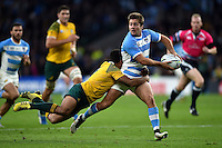Santiago Cordero of Argentina looks to offload the ball after being tackled by Will Genia of Australia. Rugby World Cup Semi Final between Argentina v Australia on October 25, 2015 at Twickenham Stadium in London, England. Photo by: Patrick Khachfe / Onside Images