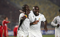 Ghana's Abeiku Quansah (7) throws kisses to the crowd as he is hugged by teammate Opoku Agyemang after scoring a goal against Hungary during the FIFA Under 20 World Cup Semi-final match at the Cairo International Stadium in Cairo, Egypt, on October 13, 2009. Costa Rica won the match 1-2 in overtime play. Ghana won the match 3-2.