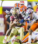 Florida State quarterback Deondre Francois takes a helmet to helmet his by Florida defensive back Marcell Harris causing a fumble and turn over in the fourth quarter of an NCAA college football game in Tallahassee, Fla., Saturday, Nov. 26, 2016. Florida State defeated Florida 31-13. (AP Photo/Mark Wallheiser)