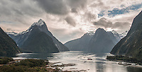 Milford Sound with Mitre Peak with morning dramatic skies and boat, Fiordland National Park, Southland, World Heritage Area, New Zealand