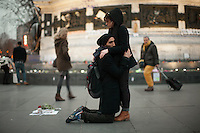 Two people take part in a silent tribute to Shaimaa El-Sabagh at Place de la République, who was shot dead by police at a march organized by her leftist party, called Popular Alliance, in Cairo, Egypt on Saturday January 24th. Photos widely distributed show Shaimaa El-Sabagh, bloody, held up by a fellow protestor following the shooting.  Kneeling is close friend of Shaimaa's Mohamed Fouad. Paris, France. Jan. 27, 2015.
