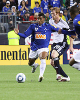 Cruzeiro forward Eber (17)  intercepts a ball intended for New England Revolution defender Pat Phelan (28).  Brazil's Cruzeiro beat the New England Revolution, 3-0 in a friendly match at Gillette Stadium on June 13, 2010