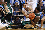 27 December 2014: UAB's Denzell Watts (in green) tries to keep the ball away from North Carolina's Marcus Paige (in white). The University of North Carolina Tar Heels played the University of Alabama Birmingham Blazers in an NCAA Division I Men's basketball game at the Dean E. Smith Center in Chapel Hill, North Carolina. UNC won the game 89-58.