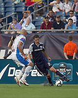 New England Revolution midfielder Marko Perovic (29) dribbles against Puebla FC defender Alejandro Acosta (3). The New England Revolution defeated Puebla FC in penalty kicks, in SuperLiga 2010 semifinal at Gillette Stadium on August 4, 2010.