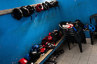 Boxing headgear and gloves seen in the boxing change room in Lima, Peru, 2 July 2013.