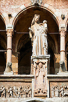 Statue of the Modonna with Child on the  facade of the Romanesque Cathedral of Cremona of the Tuscan school around 1309, Cremona, Lombardy, northern Italy