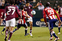 Colorado Rapids midfielder Pablo Mastroeni (25) passes the ball off in crowded conditions. The Colorado Rapids defeated CD Chivas USA 1-0 at Home Depot Center stadium in Carson, California on Saturday March 26, 2011...
