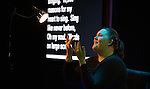 A woman translates into sign language during an April 27, 2014, worship service at the United Methodist Women's Assembly in Louisville, Kentucky.