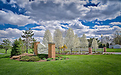 Commercial photography, signage at entrance to senior care facility in springtime.