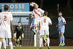18 October 2013: Syracuse's Emil Ekblom (NOR) (14) challenges for a header with North Carolina's Raby George (SWE) (behind). The University of North Carolina Tar Heels hosted the Syracuse University Orangemen at Fetzer Field in Chapel Hill, NC in a 2013 NCAA Division I Men's Soccer match. UNC won the game 1-0.