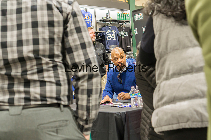 Former baseball player Darryl Strawberry sign autographs in the new Dick's Sporting Goods store in the Glendale neighborhood of Queens in New York during its grand opening on Saturday, March 11, 2017. The new store is in a location formerly occupied by the now closed Sports Authority.  (© Richard B. Levine)