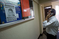 Carlos Toledo, director and founder of Nuestros Derechos--Our Rights- a Guatemalan non-governmental organization that tries to help the children off the streets and into society, takes a phone call in the children's court of the Organismo Judicial in Guatemala City.