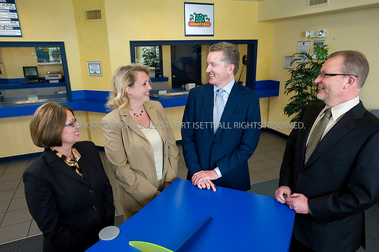 5/19/2008--Seatac, WA, USA..Founders and CEO of Money Tree. Left to right: Sara Bassford,  Aggie Clark, CEO Dennis Bassford, and Dave Bassford...©2008 Stuart ISett. All rights reserved.