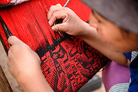 Juliana Choque weaves a traditional Jalq'a axsu in the village of Potolo, in the Cordillera de los Frailes.