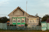 Novy Gorky, Ivanova Region, Russia, 05/08/2012..Traditional brightly painted Russian wooden homes in settlements surrounding Novy Gorky, some 200 miles east of Moscow.
