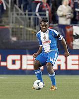 Philadelphia Union midfielder Amobi Okugo (14) passes the ball. In a Major League Soccer (MLS) match, the New England Revolution (blue/red) defeated Philadelphia Union (blue/white), 2-0, at Gillette Stadium on April 27, 2013.