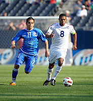Cuba's Jaine Colomé dribbles down the field while being pursued by El Salvador's Rodolfo Zelaya.  El Salvador defeated Cuba 6-1 at the 2011 CONCACAF Gold Cup at Soldier Field in Chicago, IL on June 12, 2011.