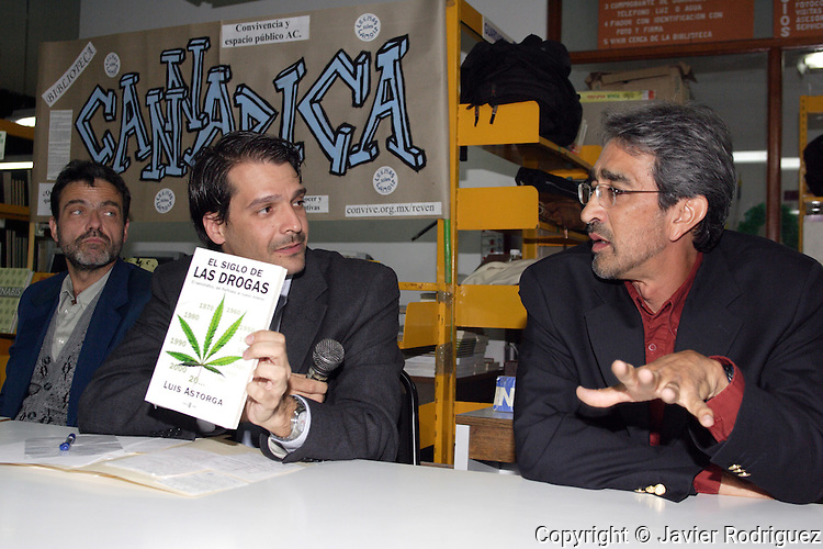 """Physicians Humberto Brocca (L), Ricardo Sala and Luis Astorga of UNAM (R) introduce the book """"The Century of the Drugs"""" by Astorga during the opening of the Cannabis Library in Mexico City, February 28, 2006. The physicians discussed about the use of drugs in contemporary societies and its relationship with violence...Photo by Javier Rodriguez"""