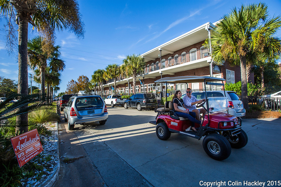 APALACHICOLA, FLA. 11/27/15-&quot;Black Friday&quot; shoppers in Apalachicola often arrive by golf cart. <br /> <br /> COLIN HACKLEY PHOTO