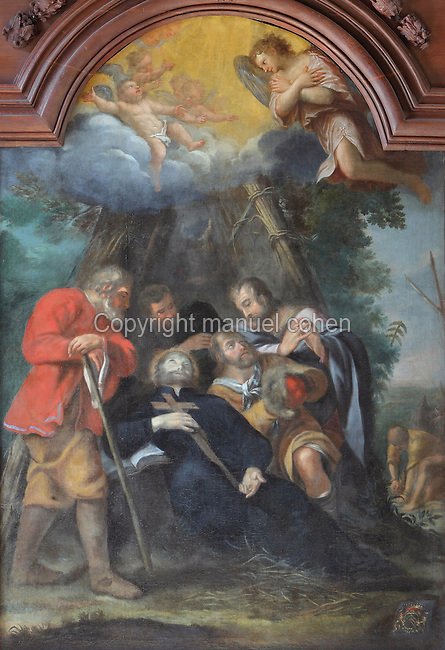 Painting of the death of a saint, possibly St Francis Xavier, 1506-52, founder of the Society of Jesus or Jesuit Order, by Jean Helart, 1618-85, French painter, in a carved wooden frame set in the wooden panelling of the refectory of the Ancien College des Jesuites or Former Jesuit College in Reims, Marne, Champagne-Ardenne, France. The College was built 1619-78 and is now the Euro-American campus of Sciences Po, or the Institut d'Etudes politiques de Paris, and the FRAC Champagne-Ardenne. It is listed as a historic monument. Picture by Manuel Cohen