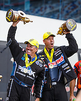 Sep 18, 2016; Concord, NC, USA; NHRA pro stock driver Jason Line (right) and funny car driver John Force celebrate after winning the Carolina Nationals at zMax Dragway. Mandatory Credit: Mark J. Rebilas-USA TODAY Sports