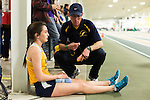 January 25, 2014. Winston Salem, North Carolina.<br /> After failing to make a personal best time in the 1600m race at the 2014 David Oliver Classic, Kayla Montgomery discusses her performance with her coach, Patrick Cromwell. She missed the time she wanted by nearly 10 seconds and was upset by the outcome. <br />  3 and a half years ago, during an examination after sustaining tailbone and head injuries from a fall during a soccer game, Kayla Montgomery, now 18, was diagnosed with multiple sclerosis. Montgomery, then a decent runner, refused to be limited by her diagnosis, and after years of training has become one of the best high school runners in the country.