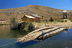 South America, Bolivia, Lake Titicaca. Uros floating reed island and boat of Lake Titicaca.