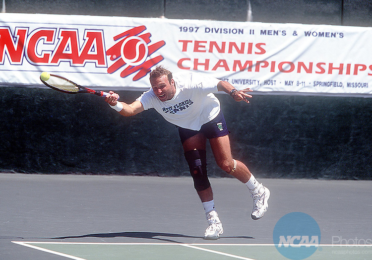 Caption: 11 MAY 1997: West Florida's Jens Gerlach reaches to return the ball during the doubles championship of the Men's and Women's Division 2 tennis championship held at the Cooper Tennis Complex in Springfield, MO. Lander defeated West Florida to take home the championship title. Andy LaValley/NCAA Photos.