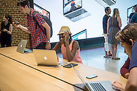 Apple enthusiasts descend on Williamsburg, Brooklyn in New York for the grand opening of Apple's first store in Brooklyn on Saturday, July 30, 2016. The tech company's new store features exposed brick, giant arch windows and at one story with a brick facade blends in with the neighborhood. Apple gave away commemorative tee-shirts to those attending the grand opening. (© Richard B. Levine)